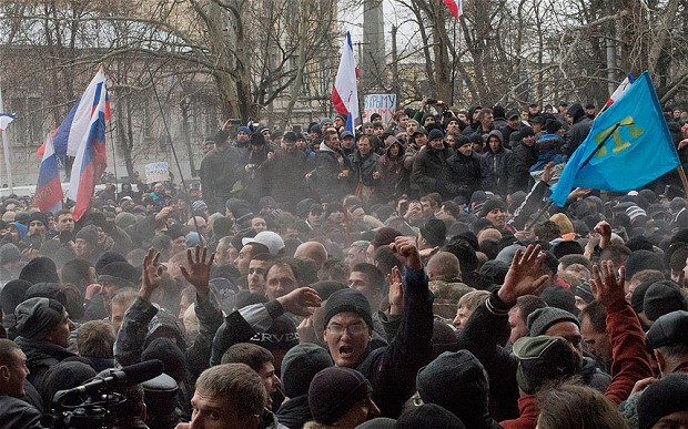 Supporters clash outside the parliament building in the Crimean capital, Simferopol