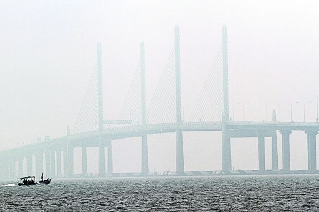 Low visibility: Smog blanketing the second Penang bridge at noon yesterday.