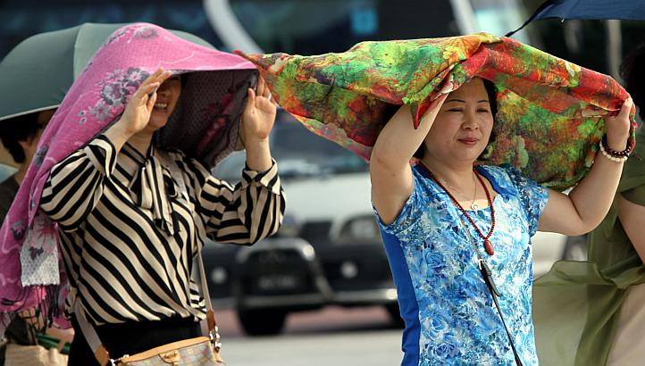 Ladies protecting themselves from the sun in Petaling Jaya