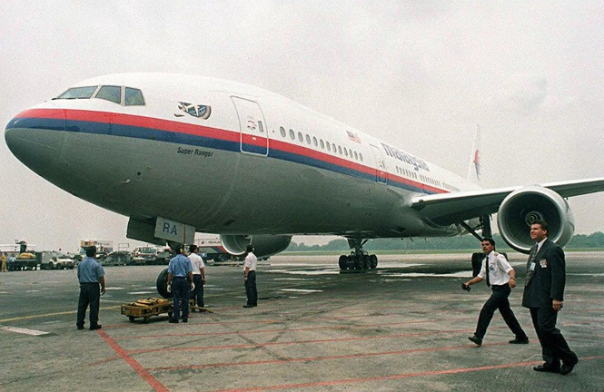 A file photo of Malaysia Airline's ground staff parking a Boeing 777-200 at Kuala Lumpur International airport.