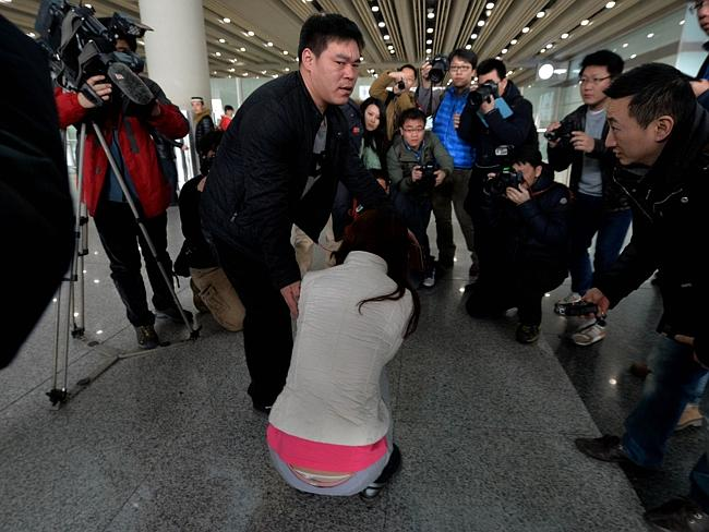 media hover over a possible relative of a passenger on the Malaysia Airlines flight