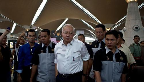 Malaysian Prime Minister Najib Razak (centre) arrives to meet family members of missing passengers at the reception centre at Kuala Lumpur International Airport, on March 8, 2014.