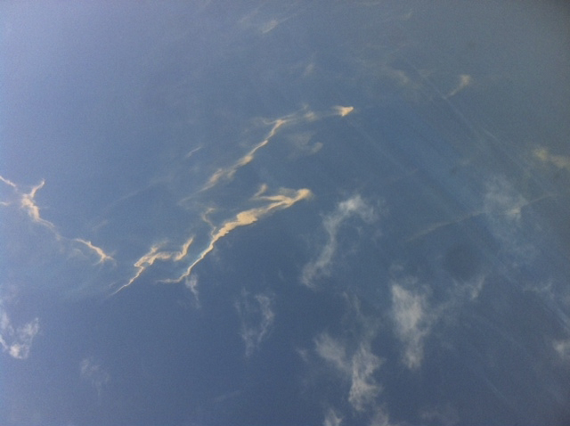 An aerial view of an oil spill seen from a Vietnamese Air Force aircraft searching for the missing Malaysia Airlines plane