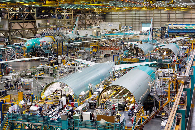 Employees working on the final assembly of a 777 jet at Boeing's factory in Everett