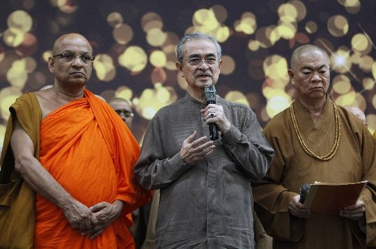 Abdullah Badawi (centre) sharing the stage with two monks before the interfaith prayers commenced at KLIA today