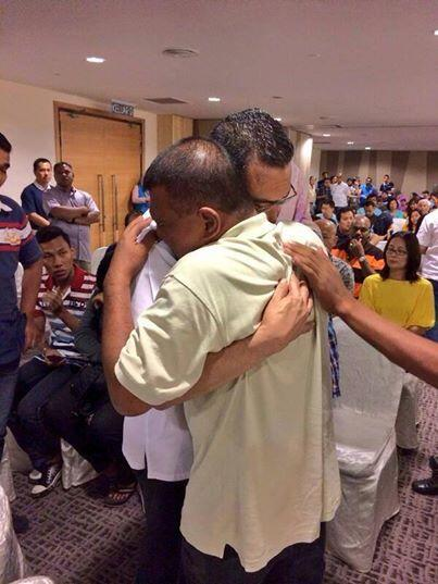 Hishamuddin hugs a worried father.