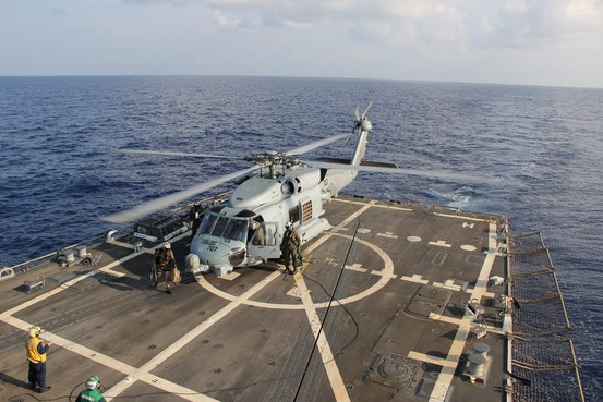 A U.S. Navy Sea Hawk helicopter landed aboard the USS Pinckney during a crew swap before returning to the search and rescue for the missing Malaysian airlines flight MH370, in the Gulf of Thailand on Sunday.