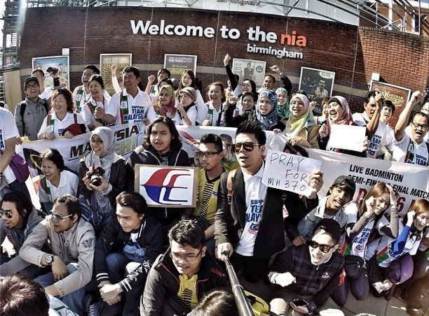 Awal Ashaari with a 'Pray For MH370' sign outside The NIA, Birmingham