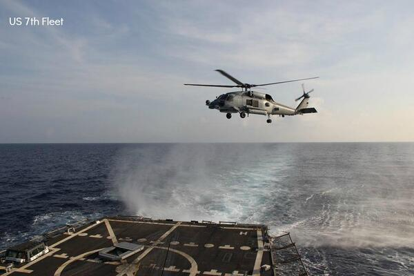 A Navy SH-60R Seahawk departs USS Pinckney on Sunday in search for missing Flight MH370