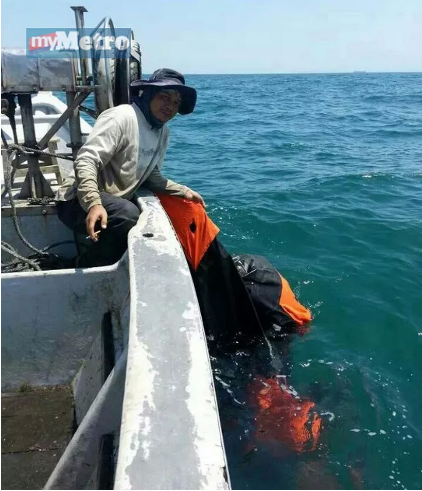 The fisherman and the life raft discovered near Port Dickson at 12pm, 11 March 2014