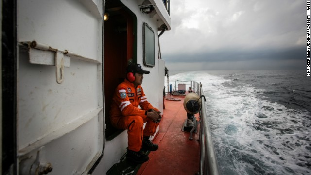 Indonesian national search and rescue agency personnel watch over high seas during a search operation for missing Malaysia Airlines Flight 370 in the Andaman Sea