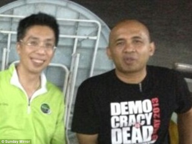 Peter Chong (left) with best friend Captain Zaharie Ahmad Shah, pilot of the missing Malaysia Airlines plane. He is pictured in a T-shirt with a Democracy is Dead slogan as police investigate claims he could have hijacked the plane as an anti-government protest.