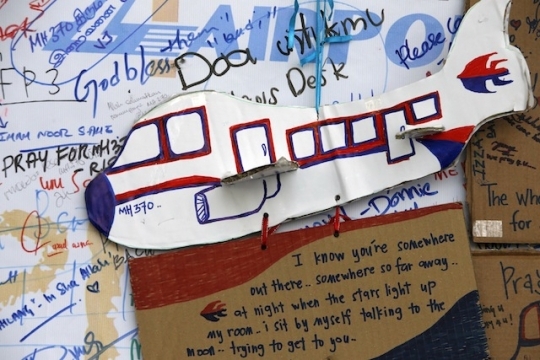 An artwork conveying well-wishes for the passengers and crew of the missing Malaysia Airlines Flight MH370 is seen at a viewing gallery in Kuala Lumpur International Airport yesterday.