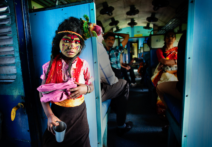 This photo taken by Arup Ghosh on a train in India is the winning shot of the 'people' category in Sony's World Photography Competition