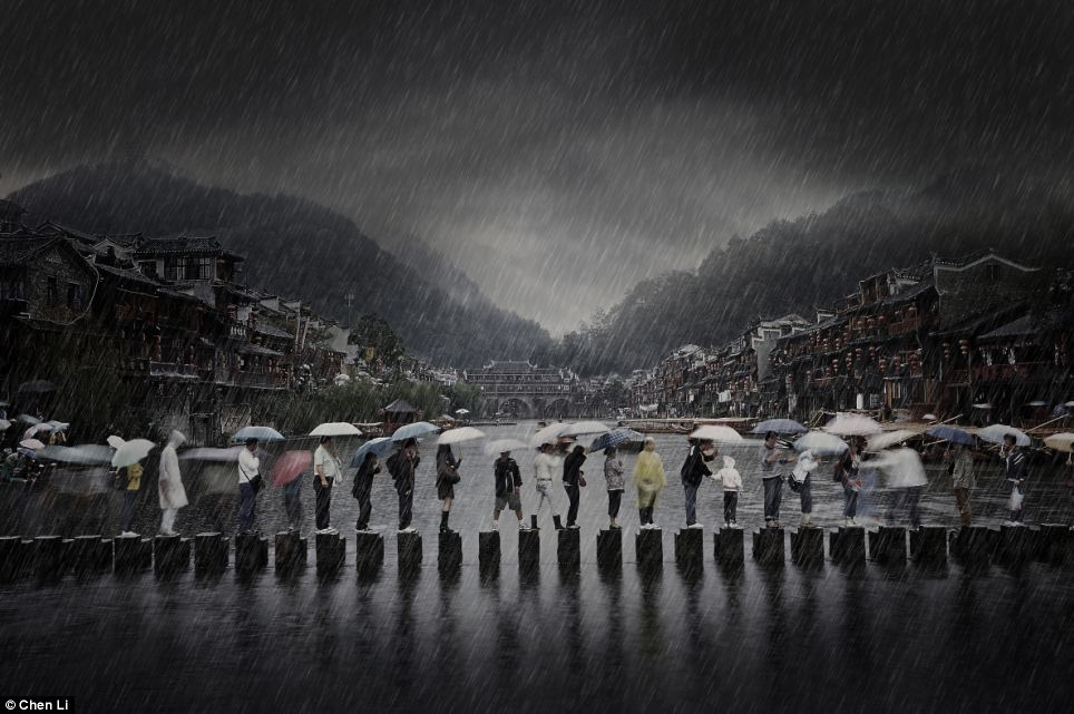 This peculiar bridge in China, with people clambering across in the torrential rain, is titled' travel' by Chen Li