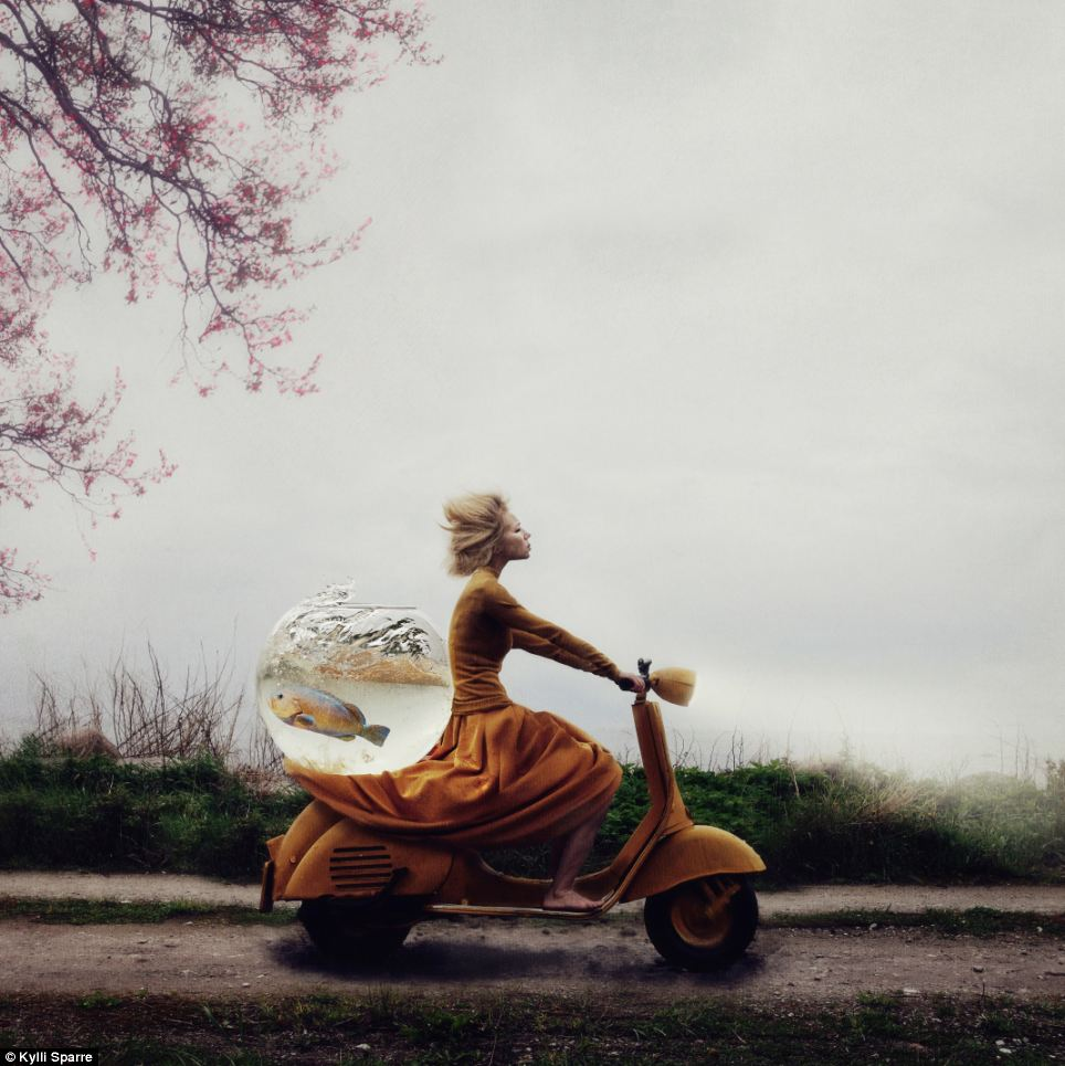 This bizarre image of a woman scooting through Estonia with a fishbowl on her Vespa was taken by Kylli Sparre