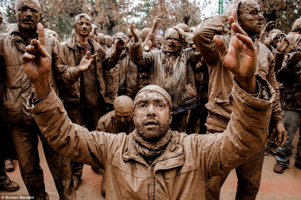 Titled 'culture', this picture taken of men covered in mud in Iran, by Borhan Mardani, was praised for its composition