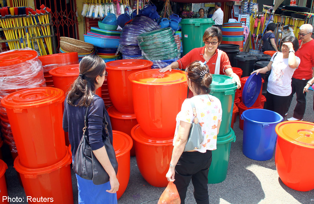 Residents buying buckets to store water during the rationing period
