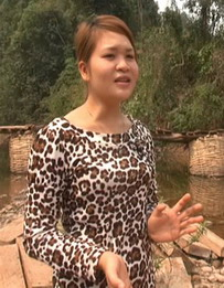 Tong Thi Minh, a 23-year-old nursery teacher at Sam Lang village, Dien Bien Province who recorded a video of her colleagues and students crossing a stream during the flood season by being pulled across in plastic bags