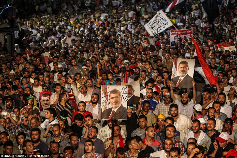 Male Morsi supporters rally in Egypt.
