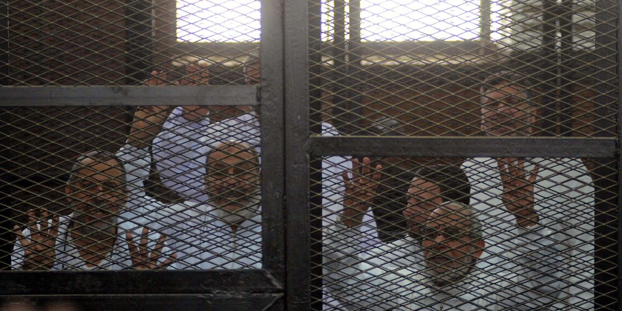 Muslim Brotherhood savages in their cages during the trial.