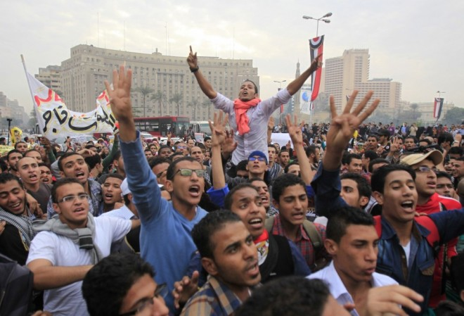 Pro-Mursi university students and supporters of the Muslim Brotherhood occupy Tahrir Square for the first time since the removal of President Mohamed Mursi in Cairo.
