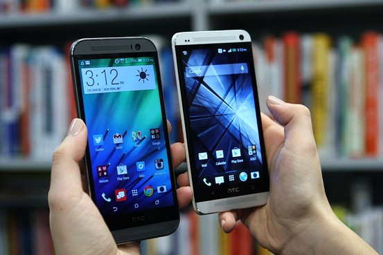 The new HTC One (M8), pictured left, replaces last year's HTC One, pictured right.