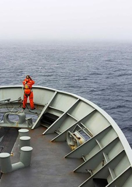 A photo provided by the Australian Department of Defence (ADF), a lookout is stationed on bow of HMAS Success during the search in the southern Indian Ocean for signs of the missing Malaysia Airlines Flight MH370