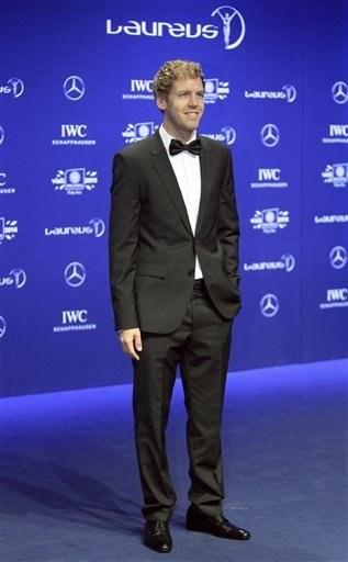 Germany's Formula One driver Sebastian Vettel poses for photos on the red carpet at the Laureus World Sports Awards in Kuala Lumpur, Malaysia, Wednesday, March 26, 2014.