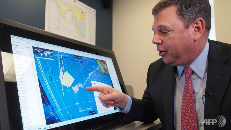 Van Gurley, senior manager with the advanced mathematics applications division of Metron speaks at the consulting firm's head office in Virginia on March 26 alongside a computer depicting the search area for Malaysia Airlines Flight 370.