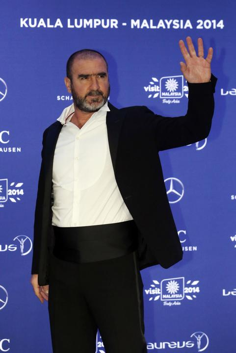 Former soccer player Eric Cantona arrives for the Laureus Sports Awards in Kuala Lumpur March 26, 2014.