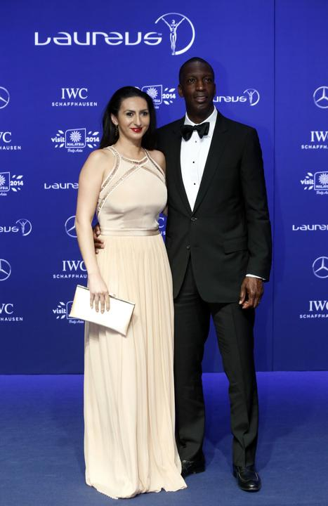 Laureus Academy member and former sprinter Michael Johnson and wife Armine Shamiryan arrive for the Laureus Sports Awards in Kuala Lumpur March 26, 2014.