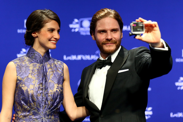 Actor Daniel Bruhl and guest attends the 2014 Laureus World Sports Awards at the Istana Budaya Theatre on March 26, 2014 in Kuala Lumpur, Malaysia.