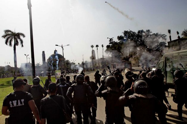 Riot police fire tear gas during clashes outside Cairo University in Giza, Egypt.