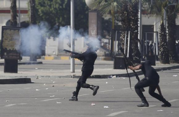 Riot police fire rubber bullets and tear gas during a demonstration at the front of Cairo University March 26, 2014.