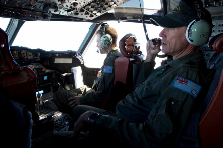 Flying Officer Stuart Doubleday, left, and Warrant Officer Michael Makin in the cockpit of a Royal Australian Air Force AP-3C Orion aircraft during a search operation for missing Malaysian Airlines flight MH370.