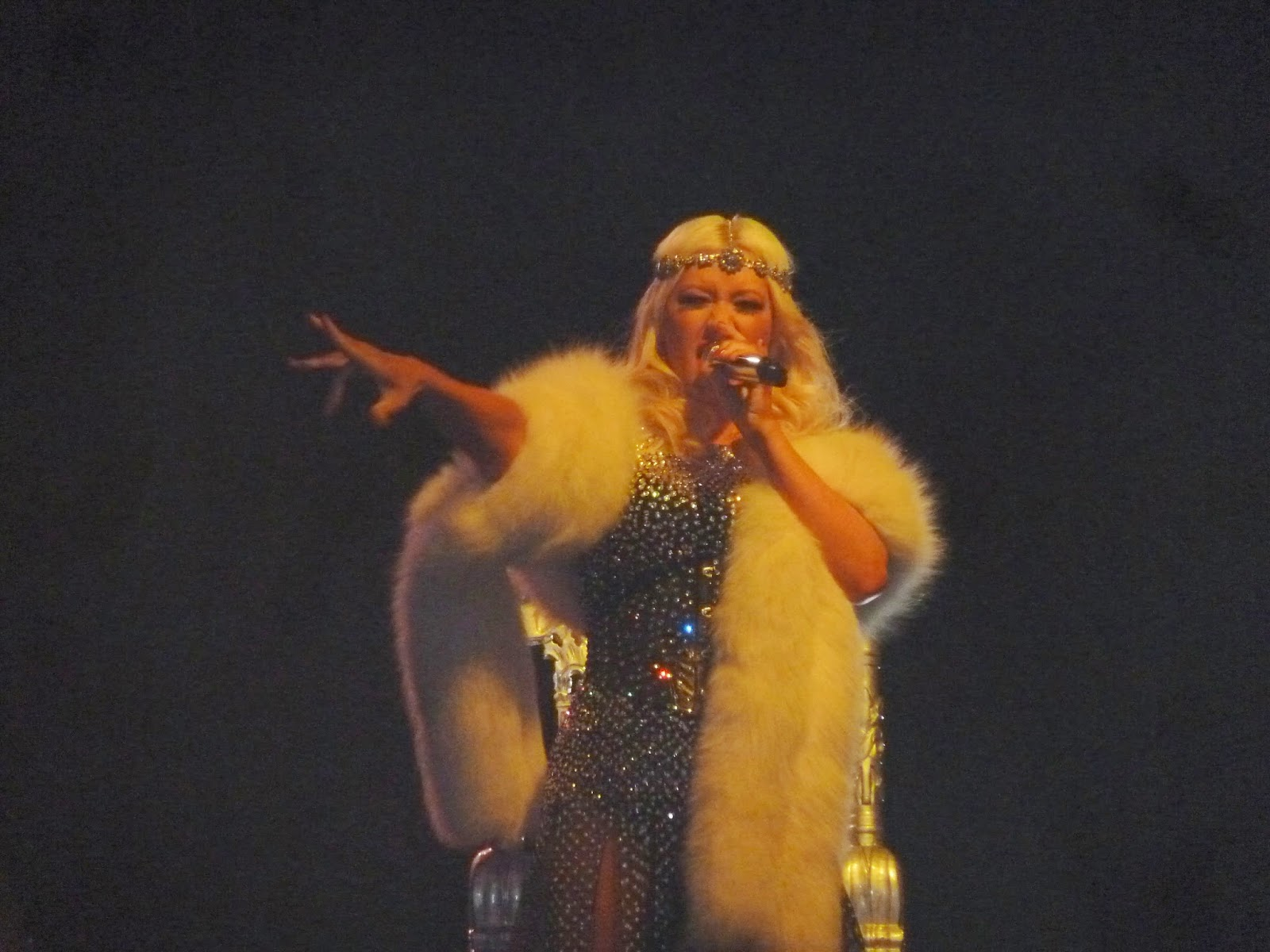 Christina Aguilera in white mink and sequinned dress.