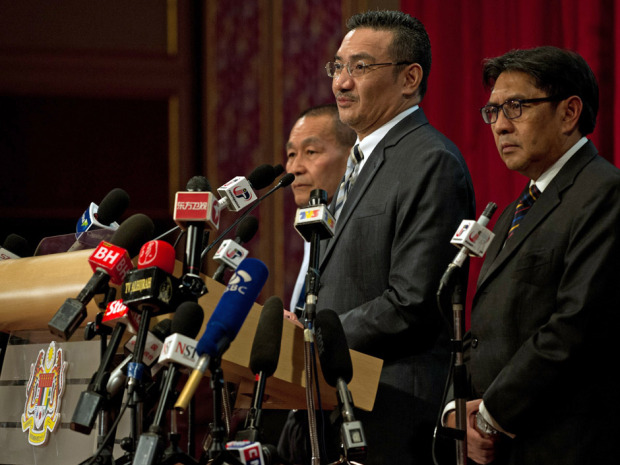 Malaysian Defence Minister Hishammuddin Hussein (2nd R) delivers a statement on missing Malaysia Airlines flight MH370 to the media at the Putra World Trade Center (PWTC) in Kuala Lumpur