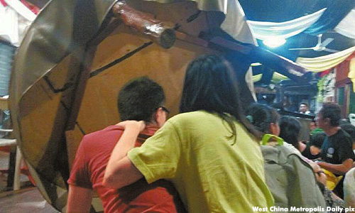 Photos shared online show tourists crouching on the floor at a dining room and men in uniforms with rifles and bullet proof vests, possibly Malaysian security personnel