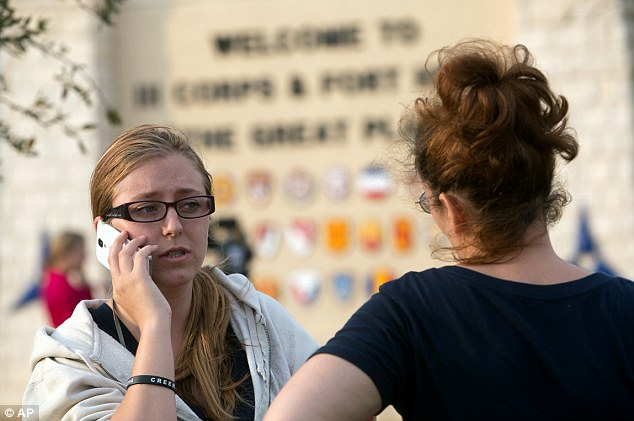 Krystina Cassidy, left, and Dianna Simpson attempt to make contact with their husbands who are stationed inside Fort Hood