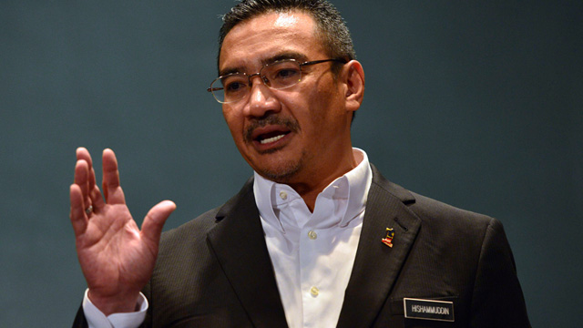 Malaysia's acting transport minister, Hishammuddin Hussein, speaking at a press conference