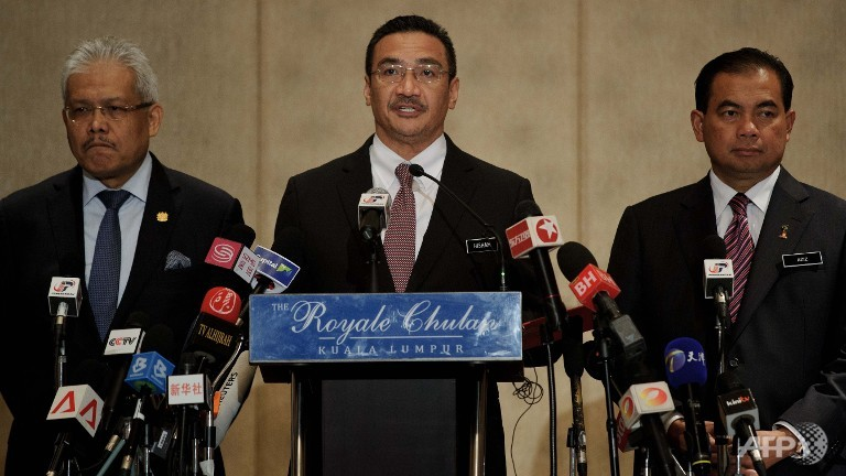 "Malaysia's Acting Transport Minister Hishammuddin Hussein (C), during a news conference on the missing Malaysia Airlines plane in KL on April 7, 2014, said the signals detected by Australian and Chinese ships are the ""most promising lead"" yet in the hunt for the missing plane."