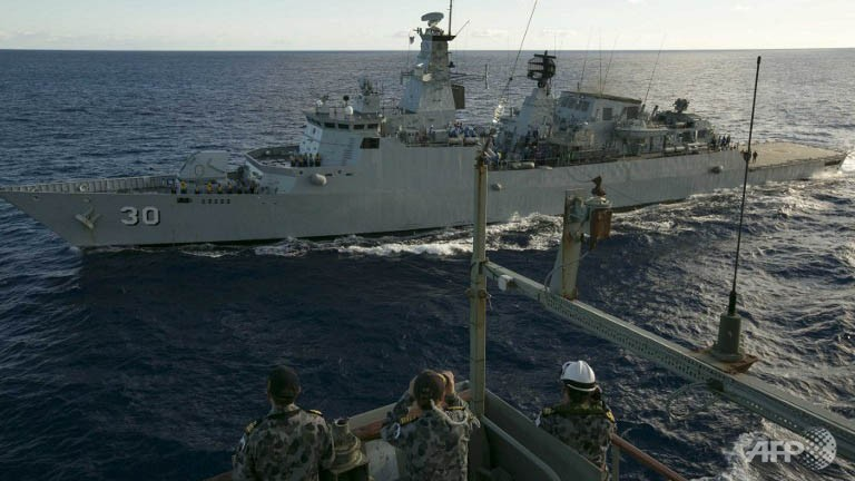 The HMAS Success as the ships complete a replenishment at sea with Royal Malaysian Navy frigate KD Lekiu whilst taking part in the search for missing Malaysia Airlines flight MH370 in the southern Indian Ocean.