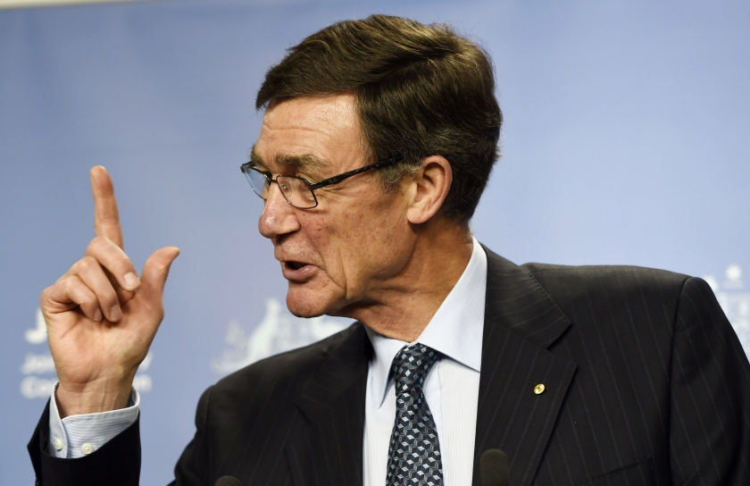 Angus Houston, a retired air chief marshal and head of the Australian agency coordinating the search for the missing Malaysia Airlines flight MH370, gestures as he addresses the media at Dumas House in Perth April 9, 2014.