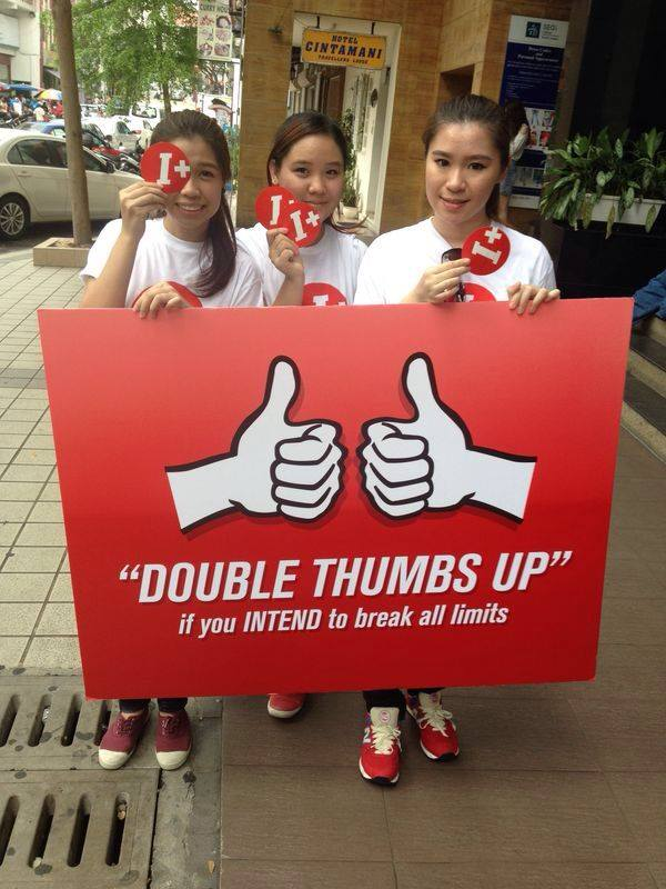 """The """"double thumbs up"""" placard"""