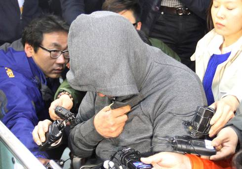 Lee Joon-Seok, captain of the South Korean ferry that capsized at sea off the coast of Jindo, is interviewed at Mokpo police station in Mokpo.