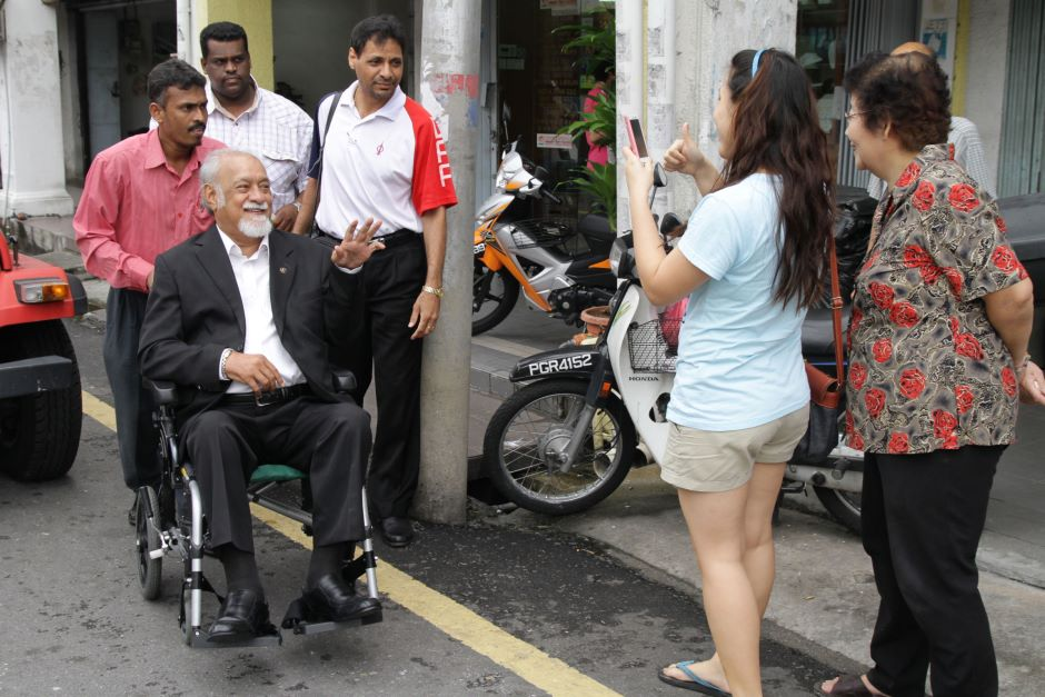 A file photo showing Michael Cornelius pushing DAP chairman Karpal Singh on his wheelchair gesturing to the public while on his way to the press conference in Air Itam on 12 Nov 2011.