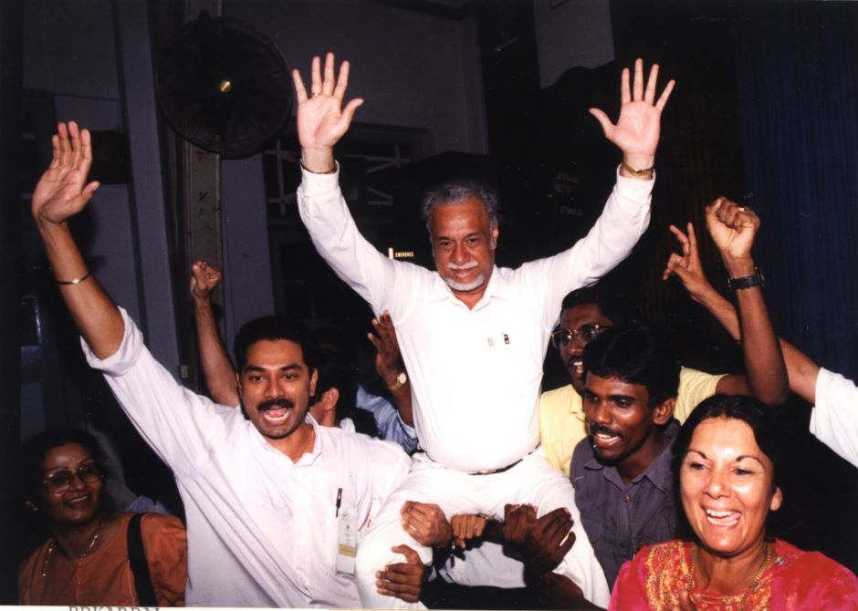 Karpal Singh up into the air by family and supporters after the announcement that he had won the Jelutong parliamentary seat.