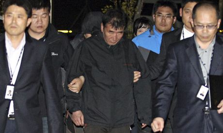 The captain of the sunken ferry, Lee Joon-seok, centre, arrives at a court in Mokpo on Friday