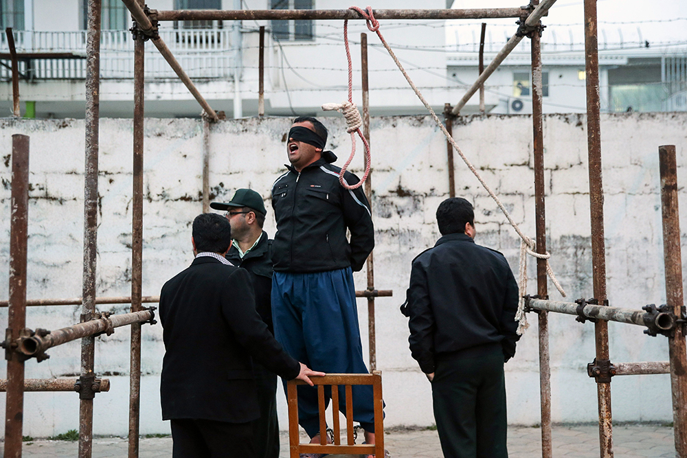 Balal, stands in the gallows during his execution ceremony in the northern city of Nowshahr on April 15